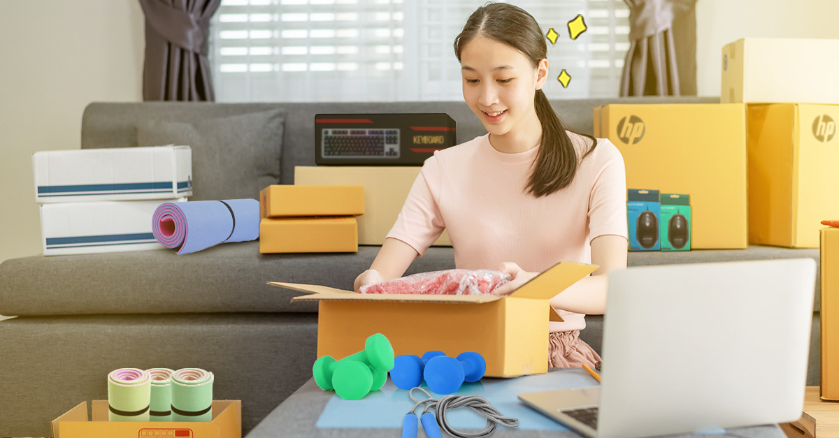 beautiful woman unpacking things she ordered for her work from home lifestyle
